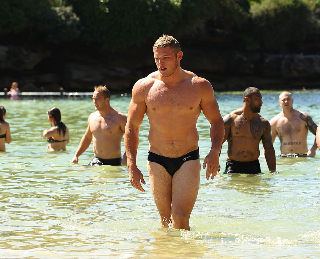 Four Burgess Brothers on same rugby team and in the surf