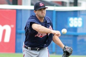 Cory Gearrin delivers his sidearmed pitch for the Gwinnett Braves.