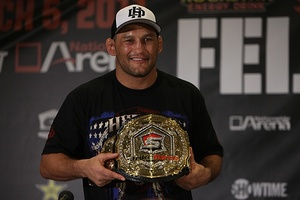 Dan Henderson modeling the Strikeforce light heavyweight title. Photo by Dave Mandel for Sherdog.com