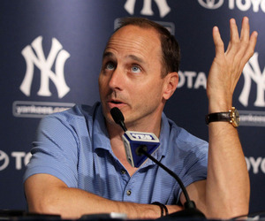 NEW YORK, NY - JULY 08:  General manager Brian Cashman of the New York Yankees speaks to the media after the game against the Tampa Bay Rays was postponed due to rain (Photo by Jim McIsaac/Getty Images)