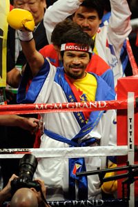 "Manny Pacquiao may be smiling, but his trainer says he's yet another athlete who is ""broke."" (Photo by Ethan Miller/Getty Images)"