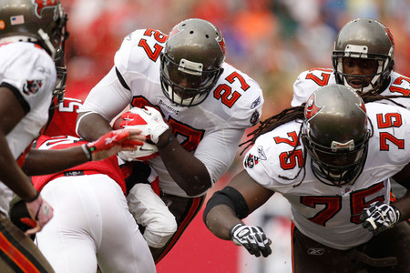 TAMPA, FL - SEPTEMBER 25:  Running back LeGarrette Blount #27 of the Tampa Bay Buccaneers runs with the ball as teammate Davin Joseph #75 blocks against the Atlanta Falcons at Raymond James Stadium on September 25, 2011 in Tampa, Florida.  (Photo by Mike Ehrmann/Getty Images)