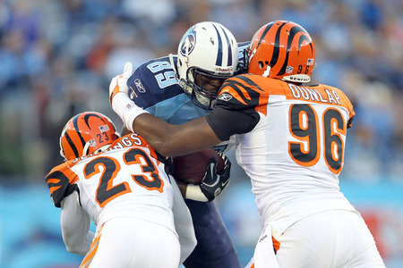 NASHVILLE, TN - NOVEMBER 06:  Jared Cook #89 of the Tennessee Titans runs with the ball and is tackled by Kelly Jennings #23 and Carlos Dunlap #96 of the Cincinnati Bengals during the NFL game at LP Field on November 6, 2011 in Nashville, Tennessee.  (Photo by Andy Lyons/Getty Images)