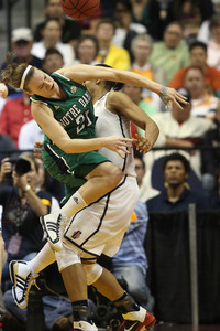 One of this year's Senior CLASS award finalists, Natalie Novosel, collides with Maya Moore, last year's winner (Photo by Elsa/Getty Images)