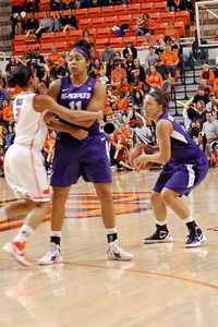Brittany Chambers gets a successful screen from Chantay Caron on Saturday in Stillwater.