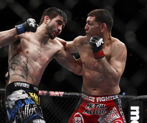 Carlos Condit and Nick Diaz exchange punches at UFC 143. Photo by Esther Lin, MMA Fighting