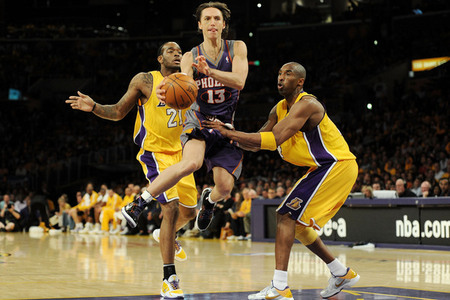 Beauty of Steve Nash's game. Even in the picture, you can't tell where the ball is going.  (Photo by Harry How/Getty Images)