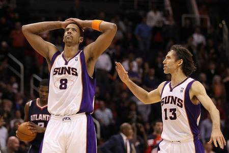 PHOENIX, AZ - FEBRUARY 15:  Channing Frye #8 of the Phoenix Suns reacts with Steve Nash #13 after Frye missed a three point shot against the Atlanta Hawks in the final moments of the NBA game at US Airways Center on February 15, 2012 in Phoenix, Arizona.  (Photo by Christian Petersen/Getty Images)