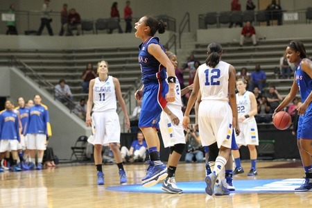 Mar 20, 2012; Little Rock, AR, USA; Kansas Jayhawks guard Angel Goodrich (3) celebrates after the game as Delaware Blue Hens guard Elena Delle Donne (11) looks on in the second round of the 2012 NCAA women's basketball tournament at Jack Stephens Center.  Kansas defeated Delaware 70-64. Nelson Chenault-US PRESSWIRE