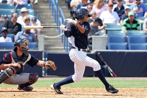 March 23, 2012; Tampa, FL, USA; New York Yankees outfielder Mason Williams (85) drives in a run in the seventh inning against the Minnesota Twins at George M. Steinbrenner Field. Mandatory Credit: Kim Klement-US PRESSWIRE