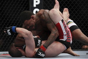 Michael Johnson lands an elbow on Shane Roller - Photo by Esther Lin for MMAFighting.com