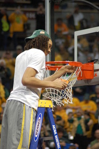 Baylor's Brittney Griner cuts down the 2012 nets in Denver.