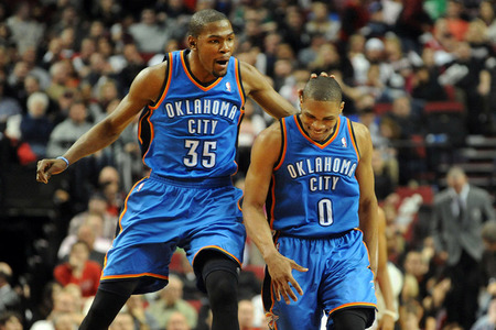Mar. 27, 2012; Portland, OR, USA; Oklahoma City Thunder small forward Kevin Durant (35) celebrates with point guard Russell Westbrook (0) after Westbrook hit a three point shot during the fourth quarter of the game against the Portland Trail Blazers at the Rose Garden. Westbrook scored 32 points as the Thunder won the game 109-95. Mandatory Credit: Steve Dykes-US PRESSWIRE