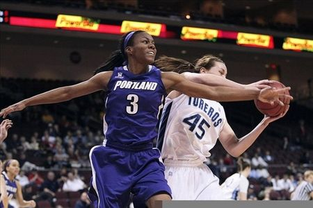 March 02, 2012; Las Vegas, NV, USA; Portland Pilots guard/forward Natalie Day (3) battles for the ball against San Diego Toreros forward Kameron Knutson (45) during the first half of the quarterfinals of the 2012 West Coast Conference Tournament at Orleans Arena. Kelley L Cox-US PRESSWIRE