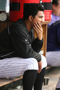 May 1, 2012; Denver, CO, USA; Colorado Rockies pitcher Jhoulys Chacin in the dugout during the first inning against the Los Angeles Dodgers at Coors Field.  Chacin gave up four runs during the first inning.  Mandatory Credit: Chris Humphreys-US PRESSWIRE