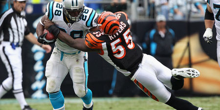 CHARLOTTE NC - SEPTEMBER 26:  Keith Rivers #55 of the Cincinnati Bengals tackles Jonathan Stewart #28 of the Carolina Panthers during their game at Bank of America Stadium on September 26 2010 in Charlotte North Carolina.  (Photo by Streeter Lecka/Getty Images)