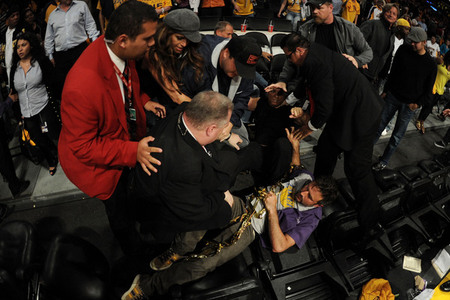 Nobody is safe in LA.  Actor David Arquette is knocked to the floor at the end of game. (Photo by Harry How/Getty Images)