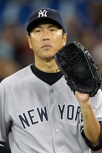 May 16, 2012; Toronto, ON, Canada; New York Yankees starting pitcher Hiroki Kuroda (18) reacts after surrendering a hit against the Toronto Blue Jays at the Rogers Centre. The Blue Jays beat the Yankees 8-1. Mandatory Credit: Tom Szczerbowski-US PRESSWIRE