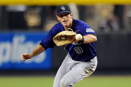 PHOENIX, AZ - JUNE 04:  DJ LeMahieu #9 of the Colorado Rockies makes a play against the Arizona Diamondbacks at Chase Field on June 4, 2012 in Phoenix, Arizona.  (Photo by Norm Hall/Getty Images)