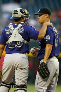 PHOENIX, AZ - JUNE 05:  Starting Pitcher Jeremy Guthrie #15 of the Colorado Rockies has a meeting on the mound with catcher Wilin Rosario #20 following a two-run home run by Aaron Hill #2 of the Arizona Diamondbacks during the second inning of a MLB game at Chase Field on June 5, 2012 in Phoenix, Arizona.  (Photo by Ralph Freso/Getty Images)
