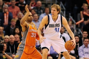 Mar. 08, 2012; Phoenix, AZ, USA;  Dallas Mavericks forward Dirk Nowitzki (41) handles the ball against the Phoenix Suns forward Grant Hill (33) during the second half at the US Airways Center.  The Suns defeated the Mavericks 96-94. Mandatory Credit: Jennifer Stewart-US PRESSWIRE.