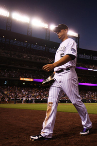 June 1, 2012; Denver, CO, USA; Colorado Rockies left fielder Carlos Gonzalez (5) walks to the dugout during  the sixth inning against the Los Angeles Dodgers  at Coors Field.  Mandatory Credit: Chris Humphreys-US PRESSWIRE