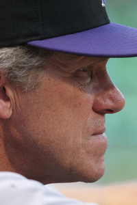 Jun 22, 2012; Arlington, TX, USA; Colorado Rockies manager Jim Tracy watches the action from the dugout in the fourth inning against the Texas Rangers at Rangers Ballpark.  Mandatory Credit: Matthew Emmons-US PRESSWIRE