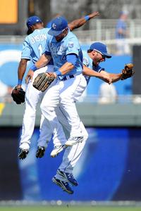 Jun 27, 2012; Kansas City, MO, USA; Kansas City Royals outfielders Jarrod Dyson (left) , Alex Gordon (center) and Jeff Francoeur (right) celebrate after the game against the Tampa Bay Rays at Kauffman Stadium. Kansas City won the game 5-4. 