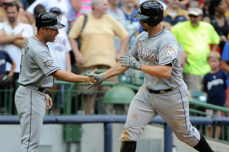 July 4, 2012; Milwaukee, WI, USA;  Miami Marlins first baseman Gaby Sanchez (15) is greeted by third base coach Joe Espada after hitting a home run in the ninth inning against the Milwaukee Brewers at Miller Park.  Sanchez was optioned to Triple-A after the game. Mandatory Credit: Benny Sieu-US PRESSWIRE