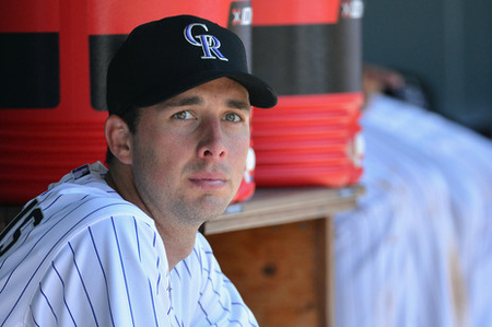DENVER, CO - JUNE 09:  Starting pitcher Jeff Francis #26 of the Colorado Rockies looks on from the dugout after leaving the game against the Los Angeles Angels during Interleague Play at Coors Field on June 9, 2012 in Denver, Colorado. Francis collected the loss as the Angels defeated the Rockies 11-5.  (Photo by Doug Pensinger/Getty Images)