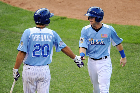 July 8, 2012; Kansas City, MO, USA; USA infielder Scooter Gennett (right) celebrates with teammate Nolan Arenado (20) after scoring a run during the sixth inning of the 2012 All Star Futures Game at Kauffman Stadium.  Mandatory Credit: Peter G. Aiken-US PRESSWIRE