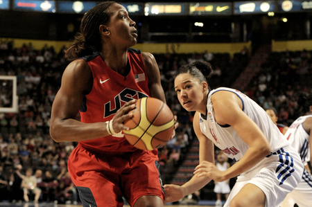 July 18, 2012; Manchester, UNITED KINGDOM; United States forward Tamika Catchings (10) looks to shoot as Great Britain center Azania Stewart defends during the 2012 London Olympic Games warm-up game at the Manchester Evening News Arena. Photo by Joe Toth-US PRESSWIRE.