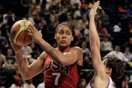 July 18, 2012; Manchester, UNITED KINGDOM; Great Britain guard Stef Collins (5) defends against United States forward Maya Moore (7) in the second half during the 2012 London Olympic Games warm-up game at the Manchester Evening News Arena.  Photo by Joe Toth-US PRESSWIRE