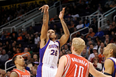 Mar. 18, 2012; Phoenix, AZ, USA; Phoenix Suns guard Shannon Brown (26) puts up a shot against the Houston Rockets guard Courtney Lee (5) and forward Chase Budinger (10) during the second half at the US Airways Center. The Suns defeated the Rockets 99-86. Mandatory Credit: Jennifer Stewart-US PRESSWIRE.