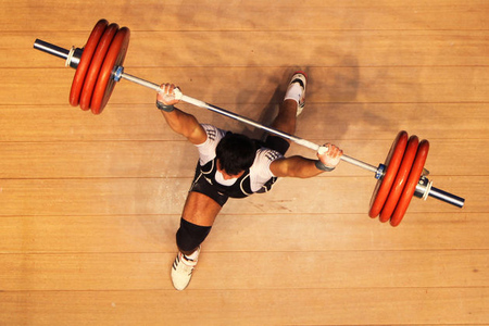 PYEONGTAEK, SOUTH KOREA - APRIL 27: Kaabi Saif Abdul Adil Jumaah of Iraq competes in the Men's 85kg during day four of the Asian Weighlifting Championships at Yichung Culture & Sports Center on April 27, 2012 in Pyeongtaek, South Korea.  (Photo by Chung Sung-Jun/Getty Images)