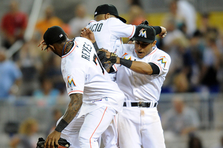 July 28, 2012; Miami, FL, USA; Miami Marlins shortstop Jose Reyes (left) second baseman Emilio Bonifacio (center) and second baseman Donovan Solano (right) celebrate their 4-2 win over the San Diego Padres at Marlins Park. Mandatory Credit: Steve Mitchell-US PRESSWIRE
