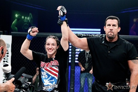 Sara McMann gets her hand raised in victory after defeating Shayna Baszler at Invicta FC 2. Photo by Esther Lin via Invicta FC