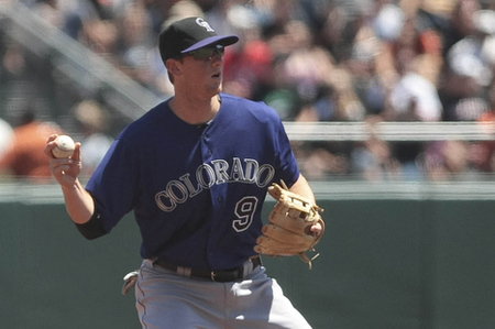 August 11, 2012; San Francisco, CA, USA; Colorado Rockies second baseman DJ LeMahieu (9) makes the out at second base but is unable to make the double play against the San Francisco Giants during the second inning at AT&T Park. Mandatory Credit: Kelley L Cox-US PRESSWIRE