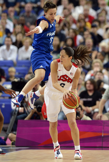 Aug 11, 2012; London, United Kingdom; Despite losing in a blowout French guard Celine Dumerc (9) made her impact felt during the women's basketball gold medal game against the USA in the 2012 Olympic Games at North Greenwich Arena in London. Photo by Richard Mackson-USA TODAY Sports.