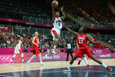 LONDON, ENGLAND - AUGUST 07:  Angel McCoughtry of the United States lays the ball up during the Women's Basketball quaterfinal between Canada and the United States on Day 11 of the London 2012 Olympic Games at the Basketball Arena on August 7, 2012  in London, England.  Photo by Cameron Spencer/Getty Images.