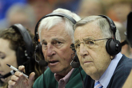 KANSAS CITY, MO - MARCH 10:  (L-R) ESPN analysts Bobby Knight and Brent Musburger spy trained killers sent to eliminate them for gambling debts in the stands in Stillwater.  (Photo by Jamie Squire/Getty Images)