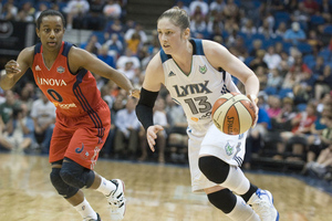AUG 17, 2012; Minneapolis, MN, USA: Minnesota Lynx guard Lindsay Whalen (13) brings the ball up court while guarded by Washington Mystics guard Shannon Bobbitt (0) in the third quarter at Target Center.  The Lynx defeated the Mystics 98-69. Photo by Marilyn Indahl-US PRESSWIRE.