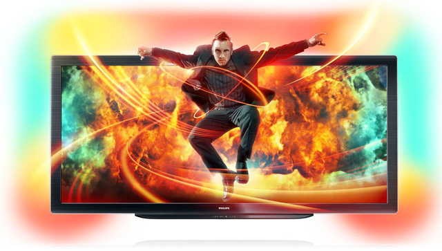 Man jumping out of 21:9 Philips TV
