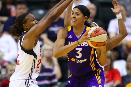 July 12, 2012; Indianapolis, IN, USA; Los Angeles Sparks forward Candace Parker (3) looks to pass off the ball as Indiana Fever forward Tamika Catchings (24) guards at Bankers Life Fieldhouse. Photo by Michael Hickey-US PRESSWIRE.
