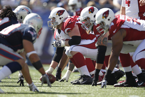 Sep 16, 2012; Foxboro, Massachusetts, USA; Arizona Cardinals center Lyle Sendlein (63) prepares to snap the ball during the second quarter against the New England Patriots at Gillette Stadium. Mandatory Credit: Greg M. Cooper-US PRESSWIRE