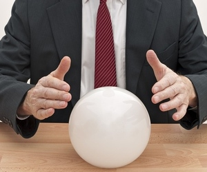 businessman with crystal ball shutterstock