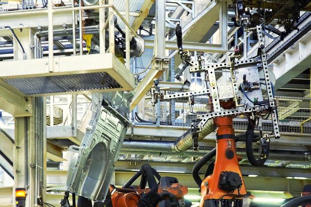 robot arms factory (nataliya hora shutterstock)