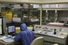 Fukushima reactor control room, suit (Credit: TEPCO)