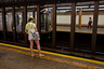 woman on subway platform larry nicosia flickr