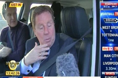 Harry_redknapp_gives_an_interview_from_his_car